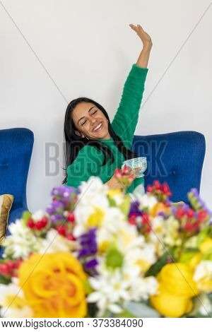 Happy Beautiful Young Woman With Her Flower Arrangement In Your Home