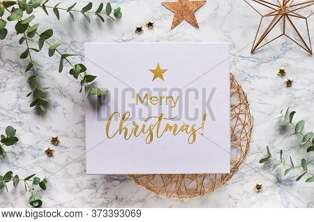 Christmas Frame With Fresh Eucalyptus Twigs And Golden Geometric Decorations - Hexagons, Trinkets An