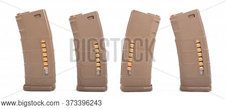 Assault Rifle Magazine Isolated On White Background. Four Sets Of Reloading Cartridges For An Assaul