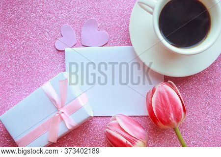 Flat Lay Photo With Coffee Cup, Gift Box And Red Tulips On Pink Background. Beautiful Mother's Day,