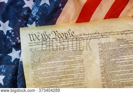 Closeup Of A Replica Of U.s. Constitution Document Of Grunge American Flag On We The People Bill Of