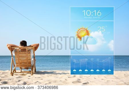 Young Man Relaxing In Deck Chair On Sandy Beach And Weather Forecast Widget. Mobile Application