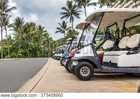 Electric Golf - Passenger Buggies Cars Parked In Row In Hamilton Island, Australia.