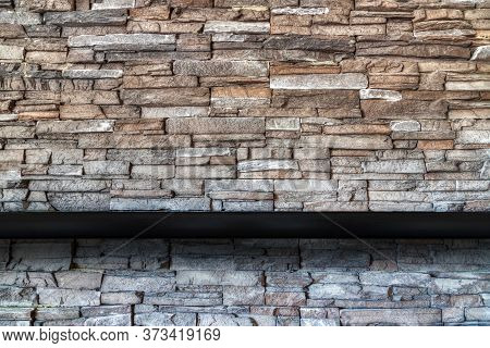 Stone Brick Wall Background With Empty Black Wooded Shelf  For Mock Up Display Or Montage Of Product