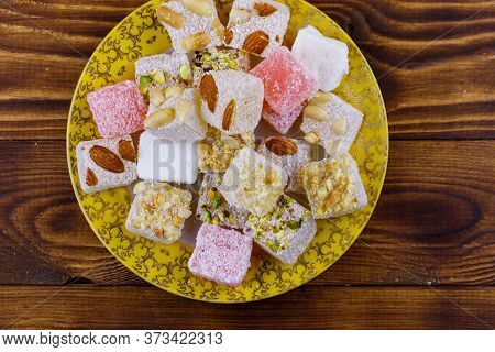 Turkish Delight In A Plate On Wooden Table