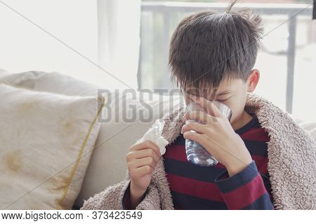Mixed Asian Sick Preteen Boy Drinking Water At Home, Heath Care Concept