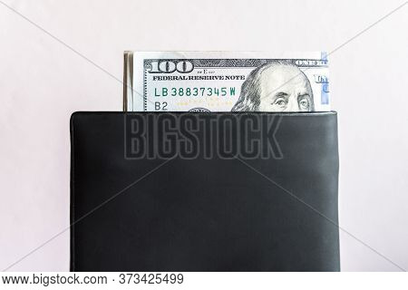 America Currency (100$ Dollars) In The Leather Wallet. The U.s. Dollar Is America's Currency, As Wel