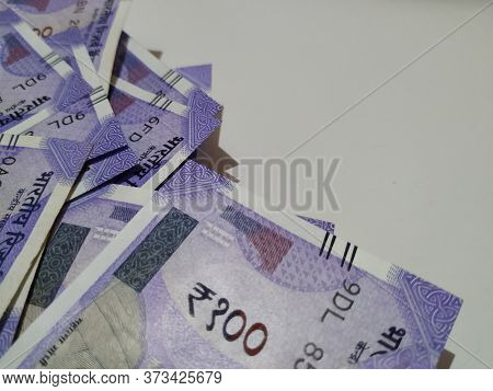 Group Of New Hundred Rupees Note Isolated In A White Background. Indian Purple Color Hundred Rupee C