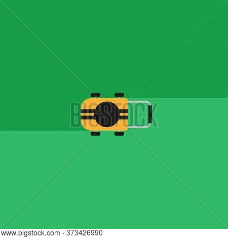 Yellow Lawn Mower On Wheels In The Process Of Cutting A Green Lawn In An Abstract Garden With Trimme
