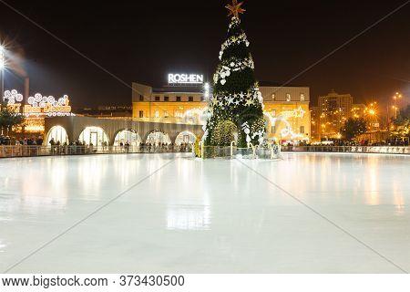 Kyiv, Ukraine - December 08, 2019: Kyiv Celebrates New Year: Ride Open-air Ice Rink In Actory Roshen