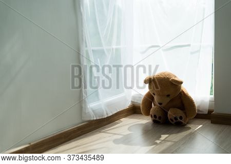 The Brown Teddy Bear Was Sadly And Disappointment. The Teddy Bear  Feeling Lonely. Child Concept Of