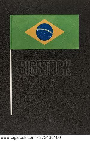 Table Flag Of Brazil On Black Background. Ordem E Progresso. Vertical Frame.