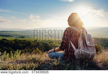 Young Hipster Girl Enjoy Sunset On Viewpoint. Travel Woman With Backpack. Enjoying Nature Sunset. Re