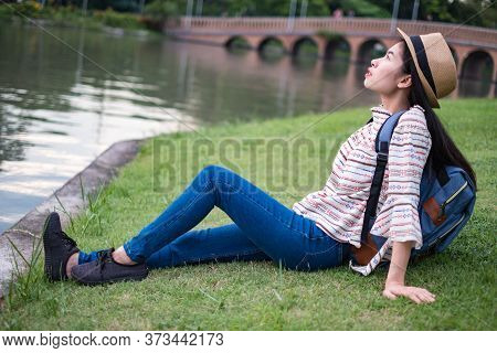 Asian Woman Tourists Backpacker See The Sky And Clouds. She Has A Happiness. During Travel. At The W