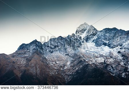 Himalaya Mountain Range Against The Blue Sky At Sunrise. Thamserku Peak. Khumbu Valley, Himalayas, E