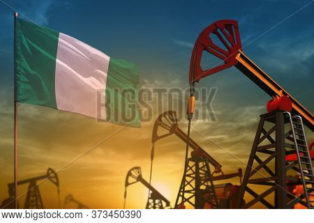 Nigeria Oil Industry Concept, Industrial Illustration. Fluttering Nigeria Flag And Oil Wells On The