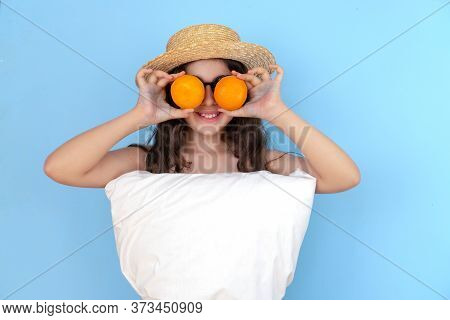 Orange A Girl On A White Background, Wearing A White Pillow Instead Of A Dress And A Fashionable Hat