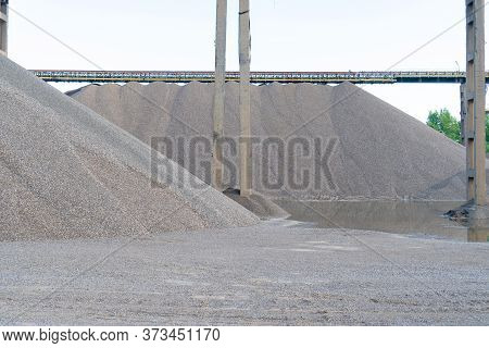 Huge Mountains Of Gravel. Ecology. Vintage Retro Effect Filtered Hipster Style Image Of An Industria
