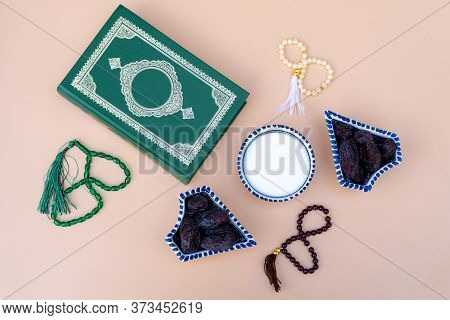 Muslim Theme: Dates, Rosary, Quran Book, Plate With Salt On A Beige Background. Bright Holiday Eid A