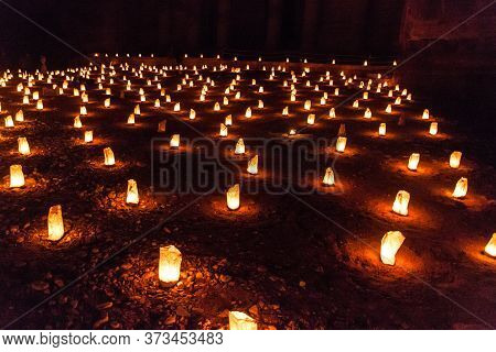 Candles Glowing In Front Of The Al Khazneh Temple The Treasury During Petra By Night In The Ancient