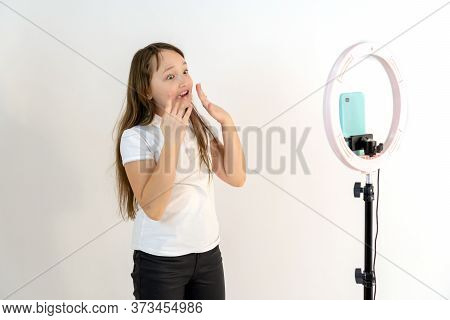A Teenage Girl Dances And Shoots A Video. Selfies. The Phone Is Mounted On A Tripod And The Ring Lam