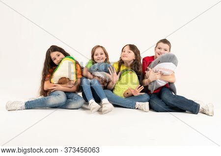 A Group Of Children In Bright Clothes With Their Favorite Soft Toys In Their Hands On A White Backgr