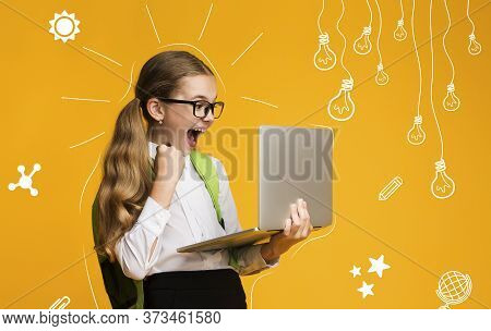 Modern Education Of Children. Overjoyed School Girl With Backpack Is Happy With Test Result, Holds L