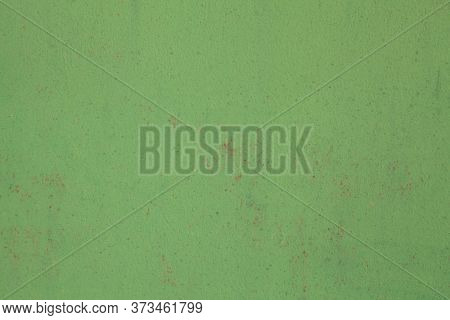 Metallic Wall Background, Texture, Colored In Green Color With Small Rusty Cracks And Paint Strokes.