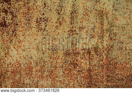 Metallic Wall Background, Texture. An Old Dirty (muddy) And Rusty Surface With Faded Uneven Colour.