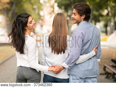 Cheating Husband Holding Hands With Wifes Best Friend Walking Together In Park Outside. Love Triangl
