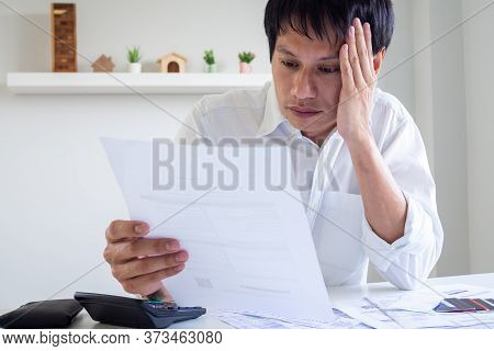 Asian Men Are Stressed About Debt Problems. Men Are Worried About Bills That Must Be Paid Monthly. D