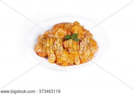 Chicken Wing In A Honey Mustard Marinade On A White Background Close-up. Raw Chicken Prime  Wings.is