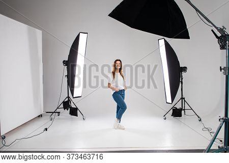 Backstage Self-confident Woman Equipment Workplace Photo Studio Concept. Photography Of Fashion Look