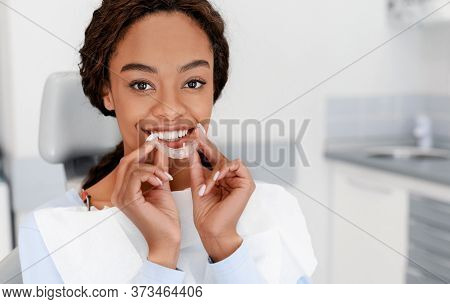 Dental Treatment Concept. Close Up Of Young Black Woman Holding Invisible Aligner, Whitening Tray, F