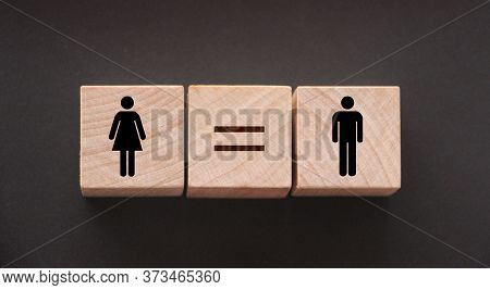 Concepts Of Gender Equality. Wooden Cubes With Female And Male Symbol And Equal Sign. Equal Pay Soci