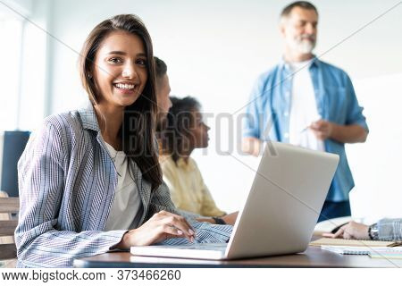 Beautiful Business Lady Is Looking At Camera And Smiling While Working In Office