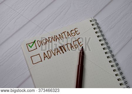 Disadvantage And Advantage Write On A Book. Supported By An Additional Services Isolated Wooden Tabl