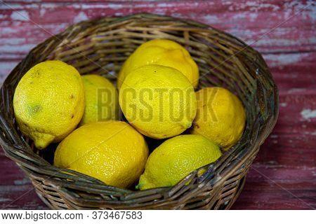 Yellow Sicilian Lemons (citrus X Limon). Citrus Fruits. Lemon. Wood Background. Fresh Fruits. Also K