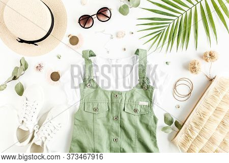 Female, Summer Street Style. Sundress, Straw Bag, Sunglasses And Tropical Leaf. Top View, Flat Lay.