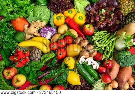 Pile Of Fruits And Vegetables In Many Appetizing Colors, Shot From Above, Inviting To Lead A Healthy