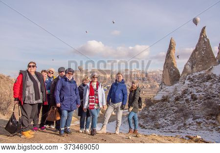Goreme, Cappadocia, Turkey - January 6, 2020: Russian Tourists Posing In The Valley Of Love In Gorem