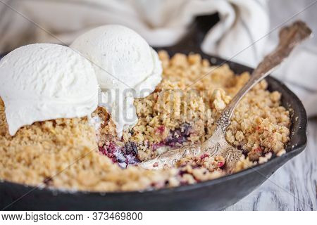 Blackberry And Blueberry Cobbler Baked In A Cast Iron Pan And Topped With A Golden Oatmeal Crisp Wit