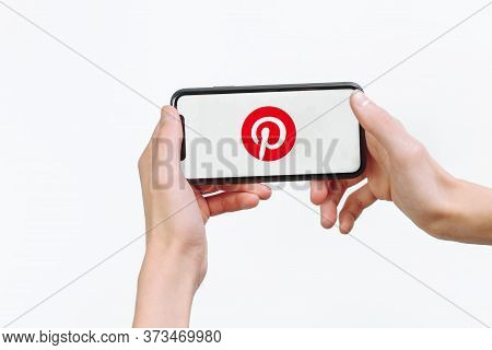 Samara Russia - 04.05.2020: A Man Holds An Iphone 11 In His Hand With The Pinterest App On A White I