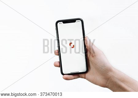 Samara Russia - 04.05.2020: A Young Man Holds In His Hand An Iphone 11 With The Shutterstock Open Ap