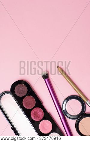 Cosmetics Is On The Pink Backgroud. Makeup In Close View. Concealer, Brush, Eyeshadow Are On The Bac