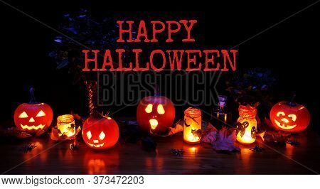 Halloween - Pumpkins And Candles With A Warm And Cold Glow, Against The Background With Text Happy H