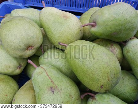 Green Pear (pyrus) Fruit Vegetarian Food On Display For Sale