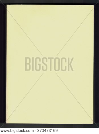 Close Up Of A Yellow Paperboard Cover Of A Book