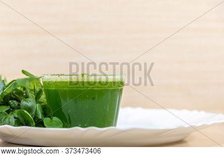 Watercress Juice And Salad (nasturtium Officinale) Served In White Porcelain Dish
