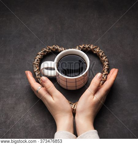 Cup Of Fresh Just Made Cup Of Americano Coffee With Womans Hands As Symbol Of Caffeine Addiction.